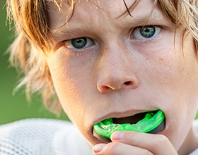 boy putting in mouthguard