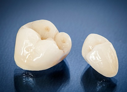 two dental crowns on desk