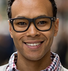 man in glasses smiling