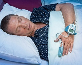 man with sleeping monitor