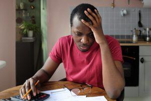 a man worried about bills