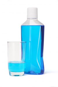 bottle of blue mouthwash white top