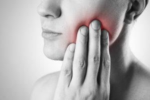 A woman with jaw pain.